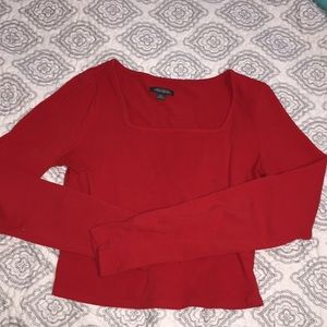 Red long sleeve square crop top.